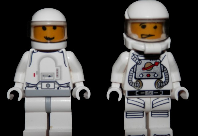 Two (LEGO) astronauts with custom drawn-on faces.